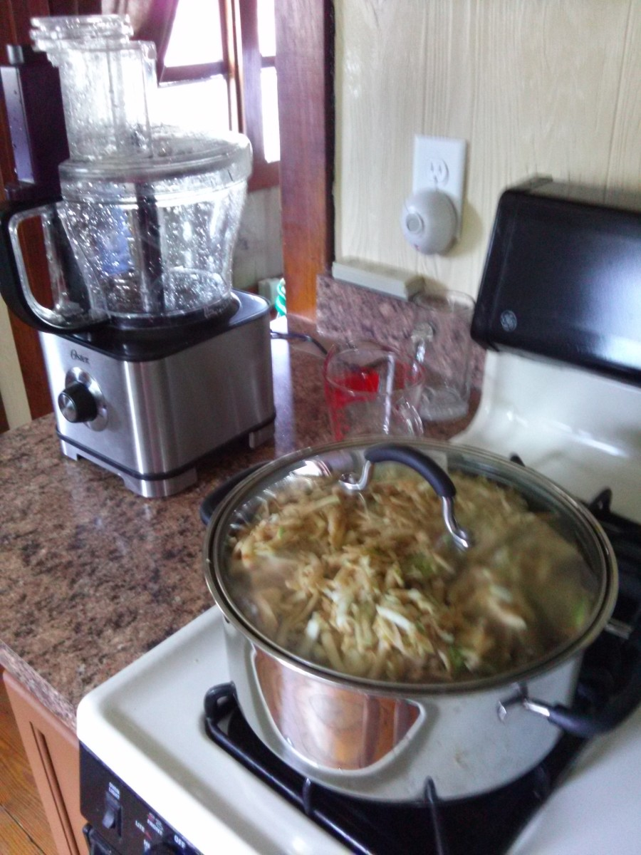 Quartered apples are run through a food processor and cooked down to a sauce.