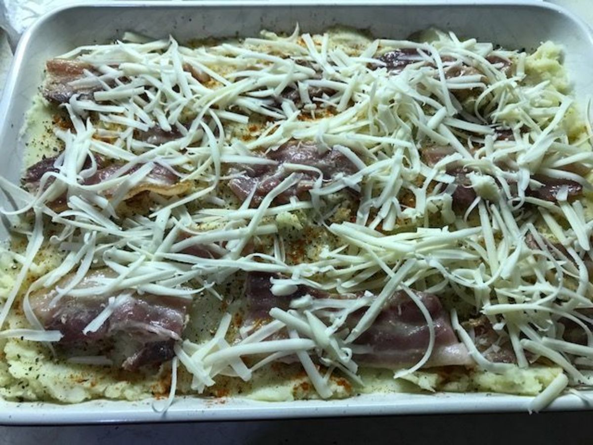 Add the grated cheese and pop it into the oven.