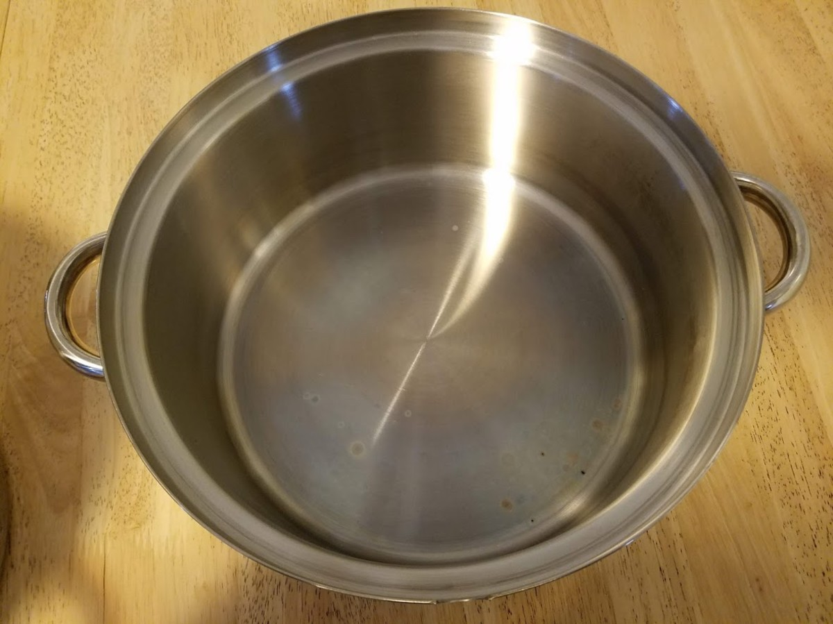 The bottom pan holds water used to steam the fruit.