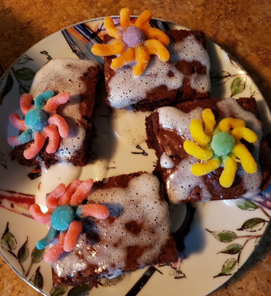 Place a Trolli sour candy on each brownie.