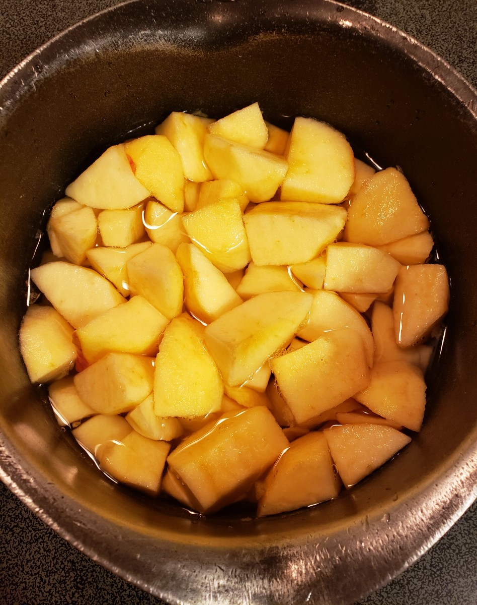 Fill pan with water, just enough to cover the top of the apples. Cook over medium heat until soft.