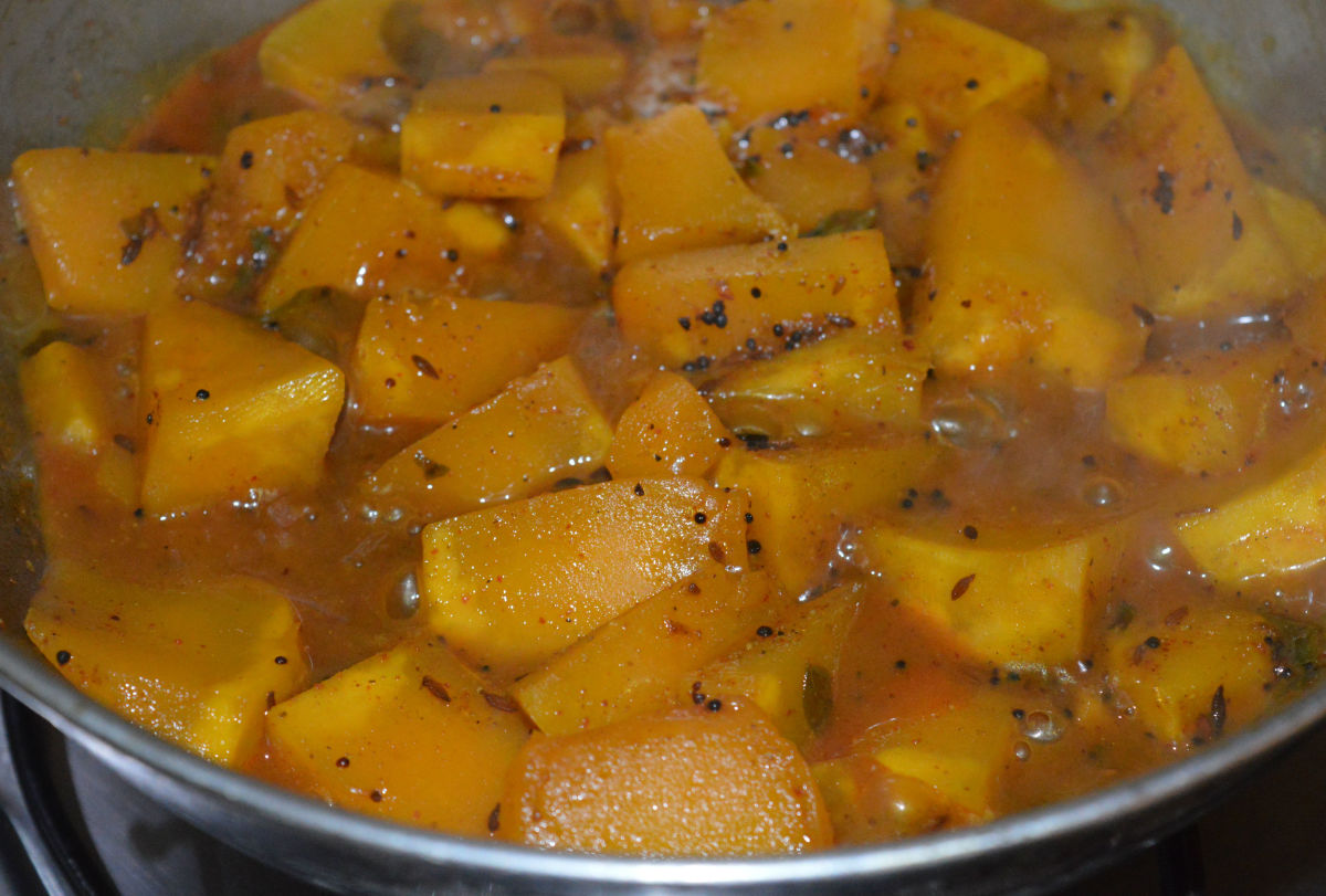 The yellow pumpkin will change its color and become soft when it's fully cooked.