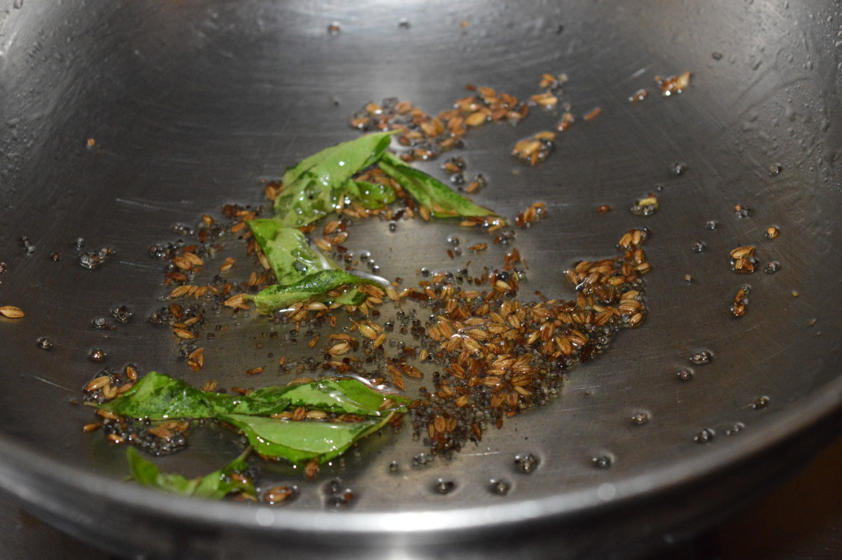 Step 1: Heat oil in a deep-bottomed pan. Add mustard seeds. Allow them to crackle. Throw in cumin seeds and curry leaves. Saute for 10 seconds. Reduce heat to minimum.