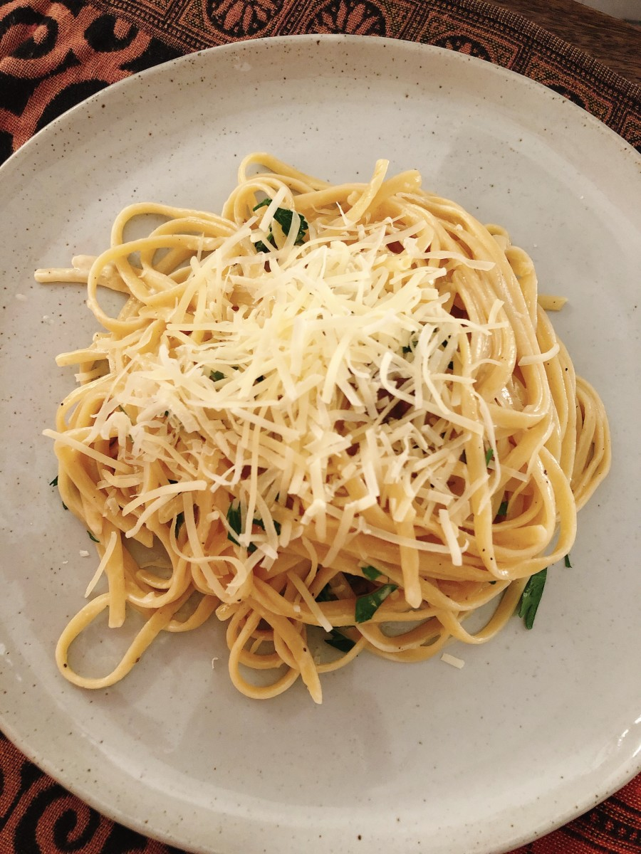 Serve the cooked pasta onto plates and top with some shredded Parmesan cheese.
