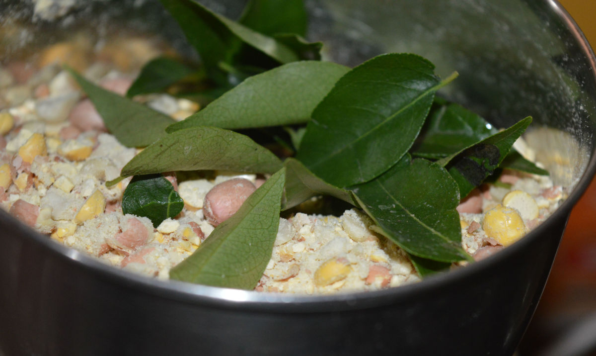 Add curry leaves to the mixer or blender and pulse once again.