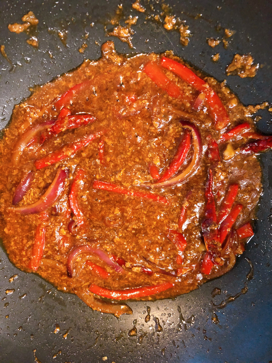 Combine the soy sauce, honey, dried chilies, salt, and pepper.