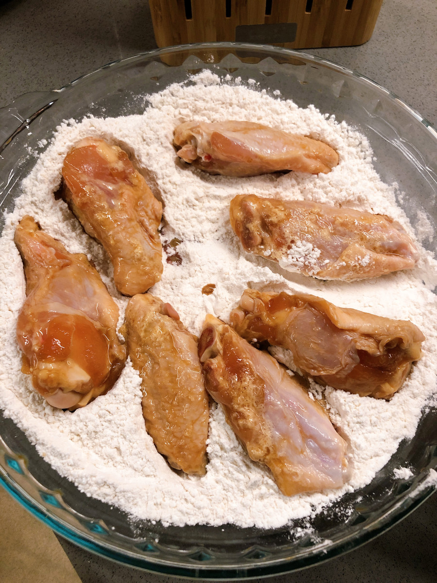 Dredge the chicken pieces through the dry mixture.