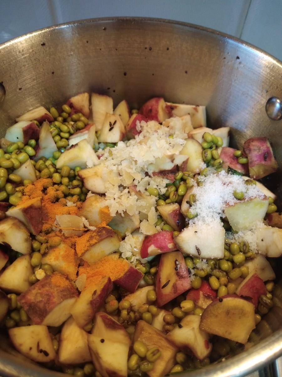 Add salt, turmeric powder, and jaggery.
