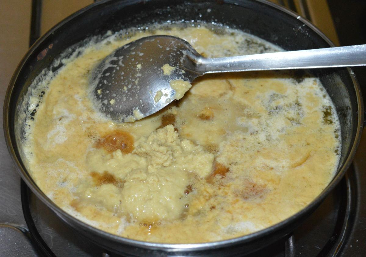 Keep the heat medium-high. Stir the mixture with a spatula.