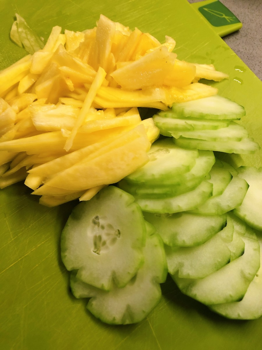 Thinly sliced cucumber, pineapple, and mango.