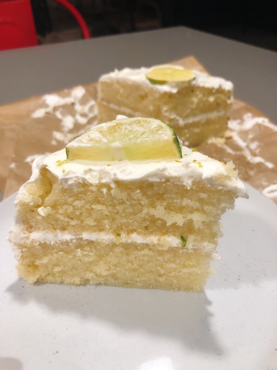 A slice of delicious and moist key lime cake.