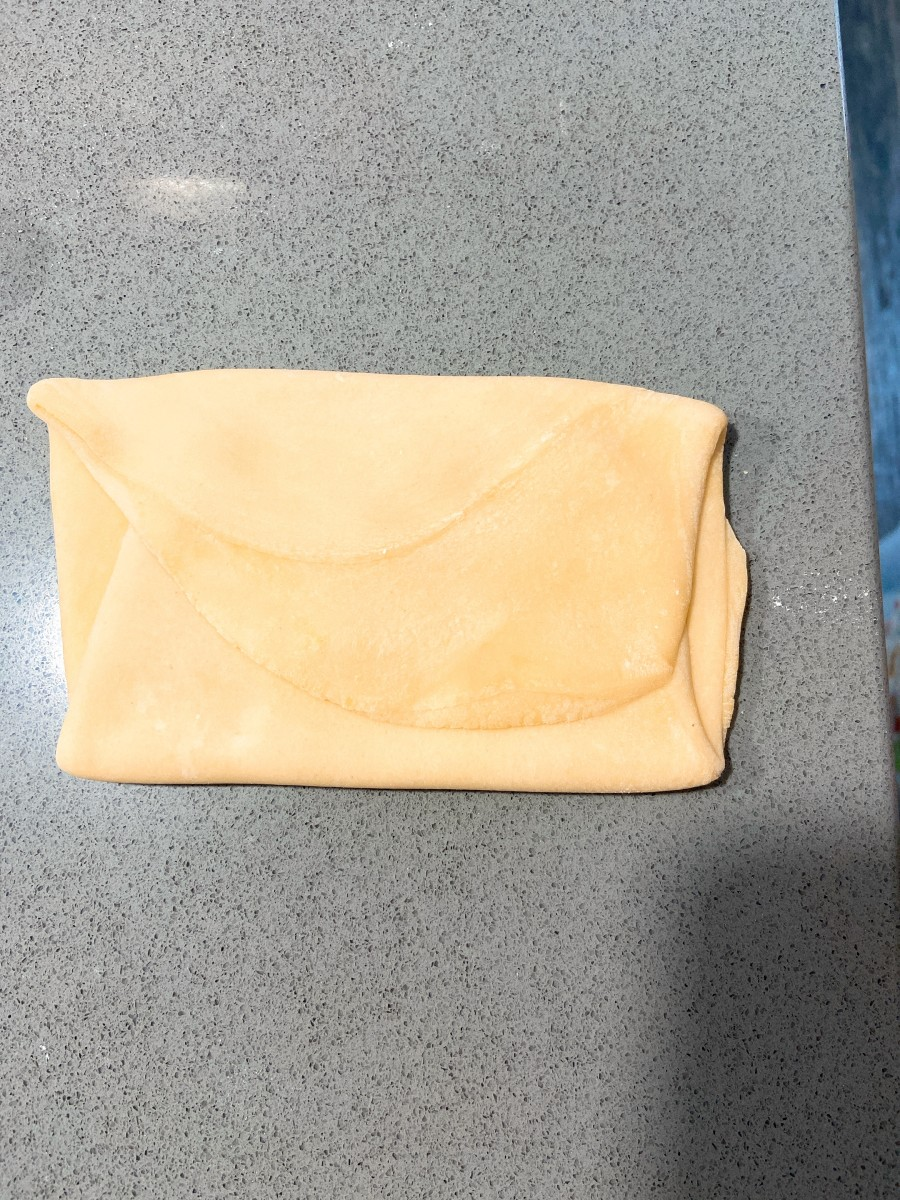 Shape one piece of dough into a 1/2-inch-thick rectangle.
