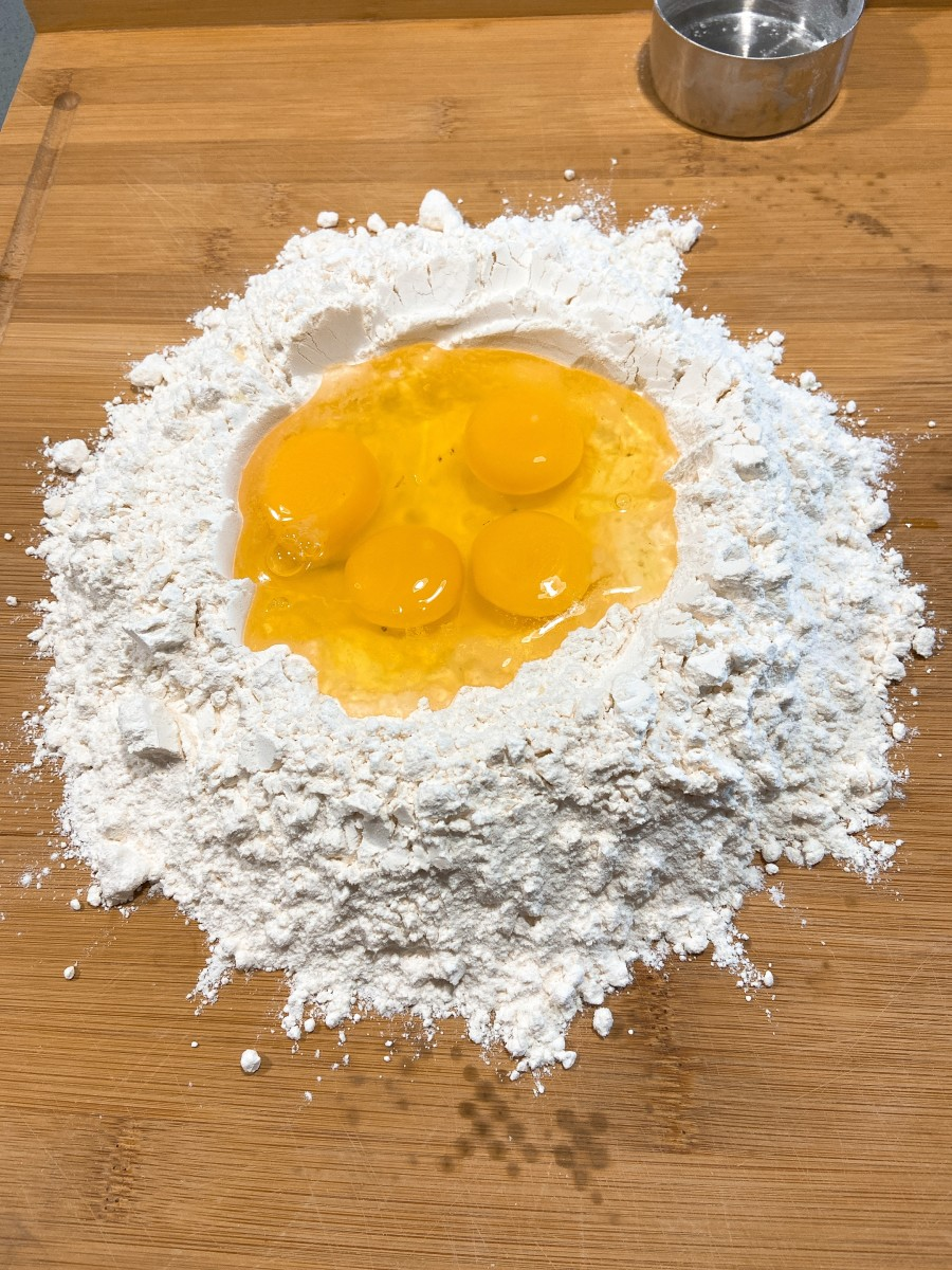 Form a well in the middle of the flour. Crack the eggs in the middle of the well.