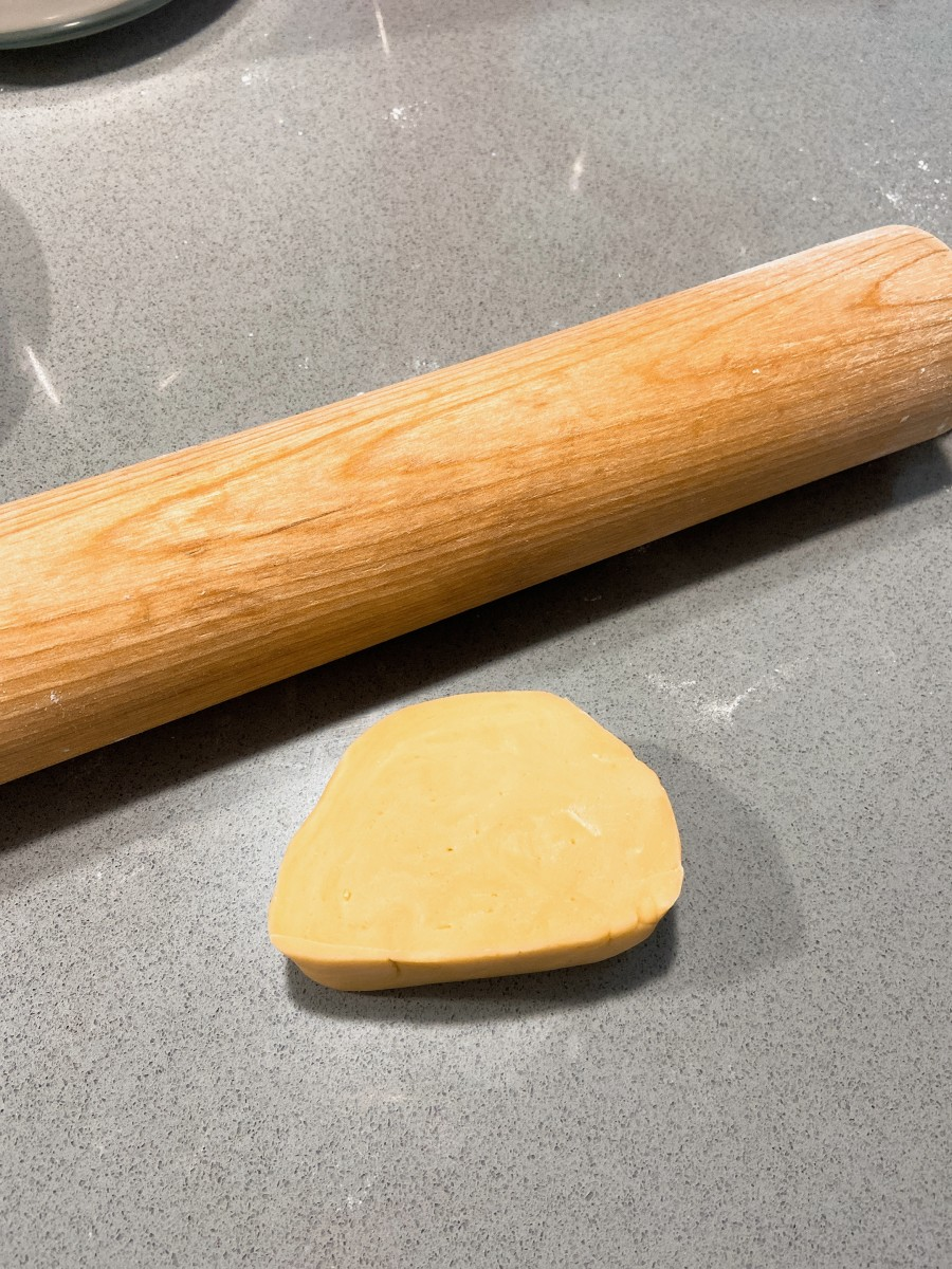 Cut the dough into a few pieces. Use a rolling pin to flatten the dough.