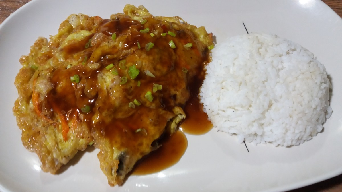 Serve egg foo young with steamed rice