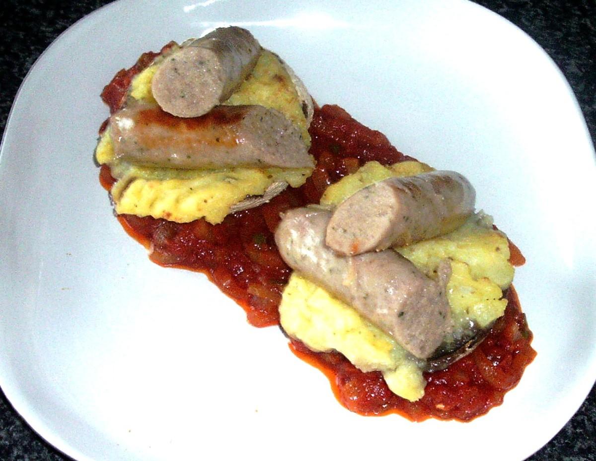 Sliced sausages are arranged on stuffed mushrooms