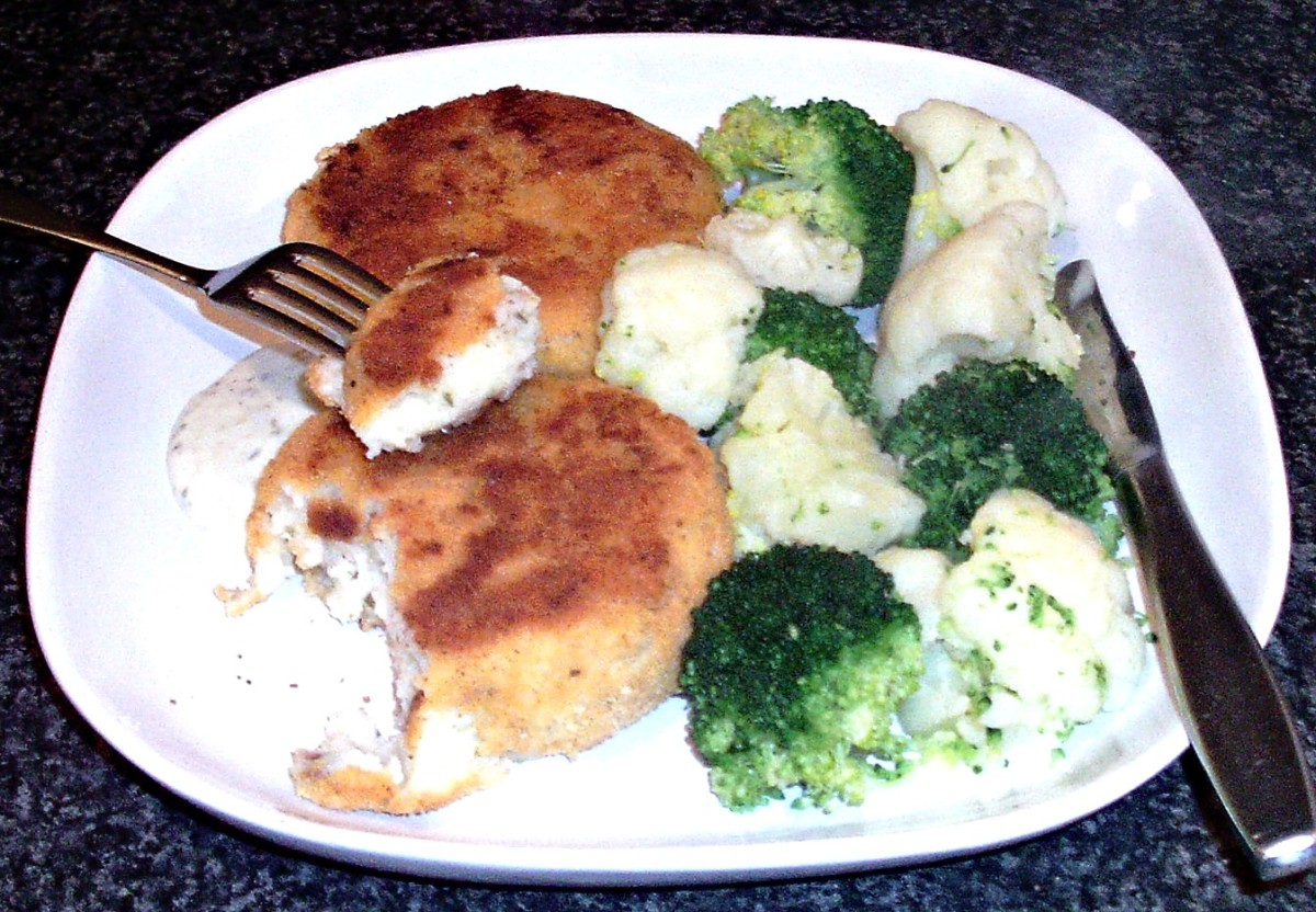 Pollack and tarragon fishcakes are served with broccoli, cauliflower and tartare sauce