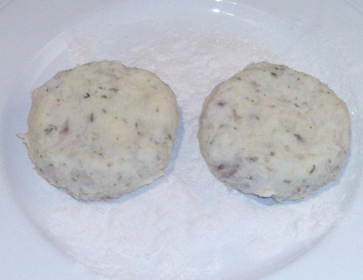 Formed fishcakes on flour