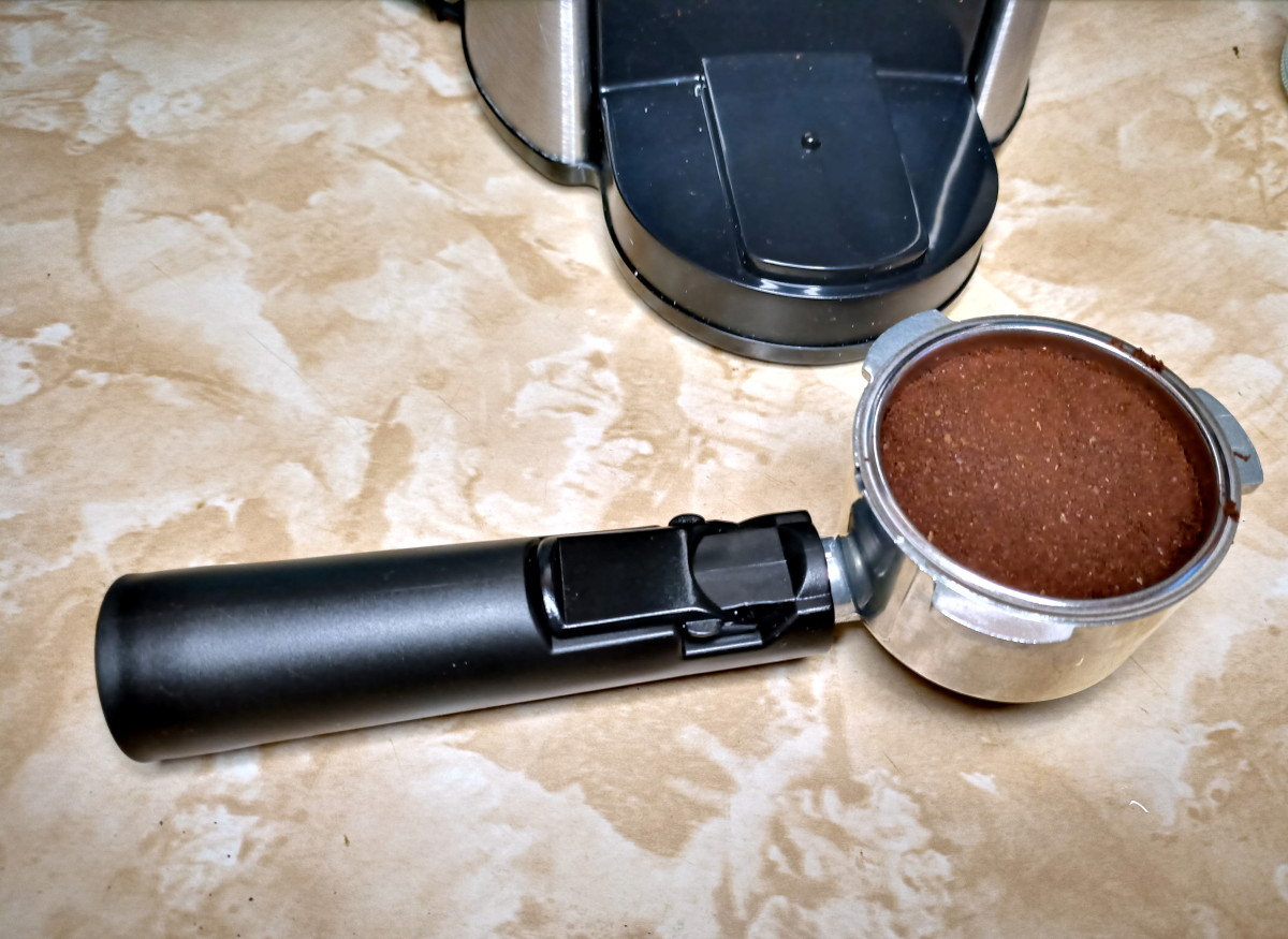 Porta-filter and two-shot filter filled with coffee grounds