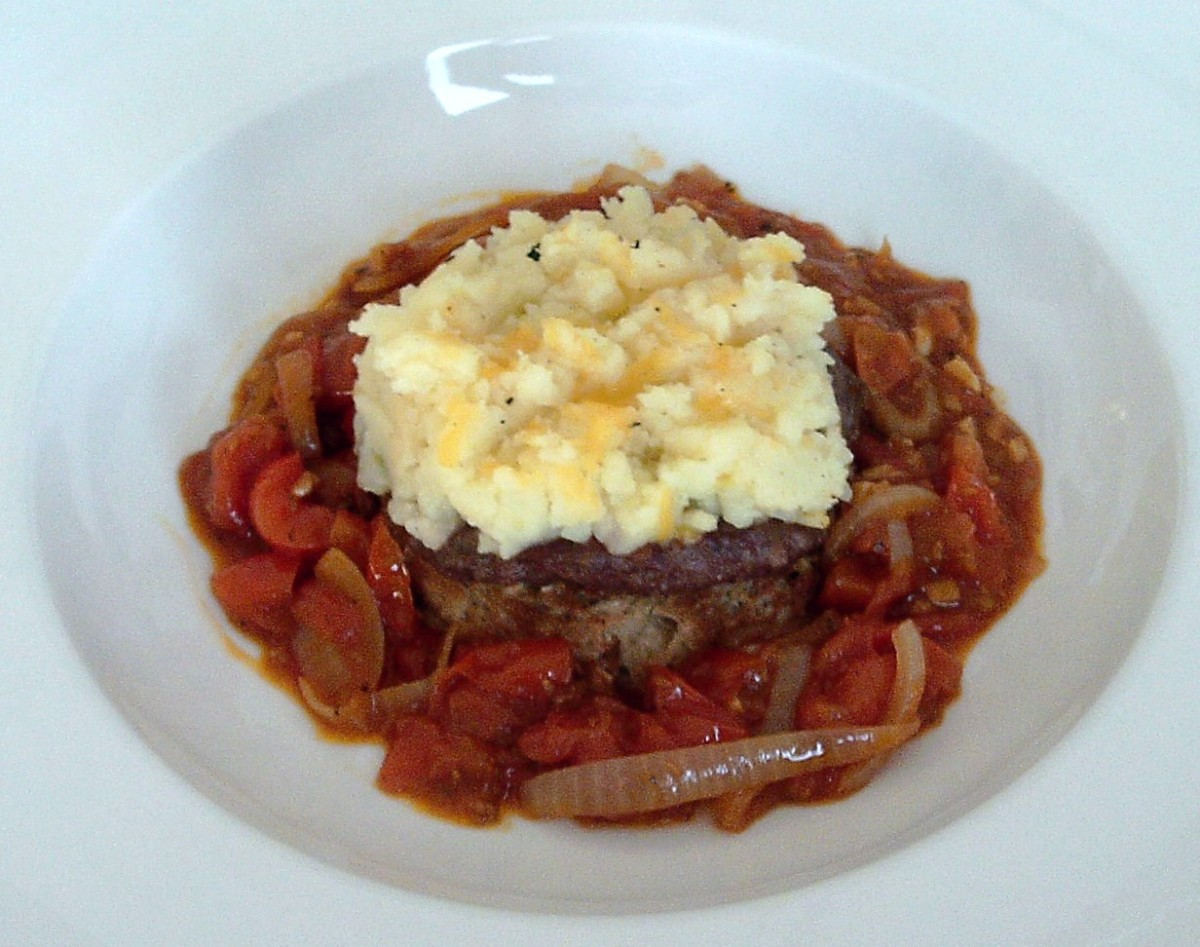 Buffalo, tomato and basil burger topped with crispy cheese mash and served with homemade tomato sauce