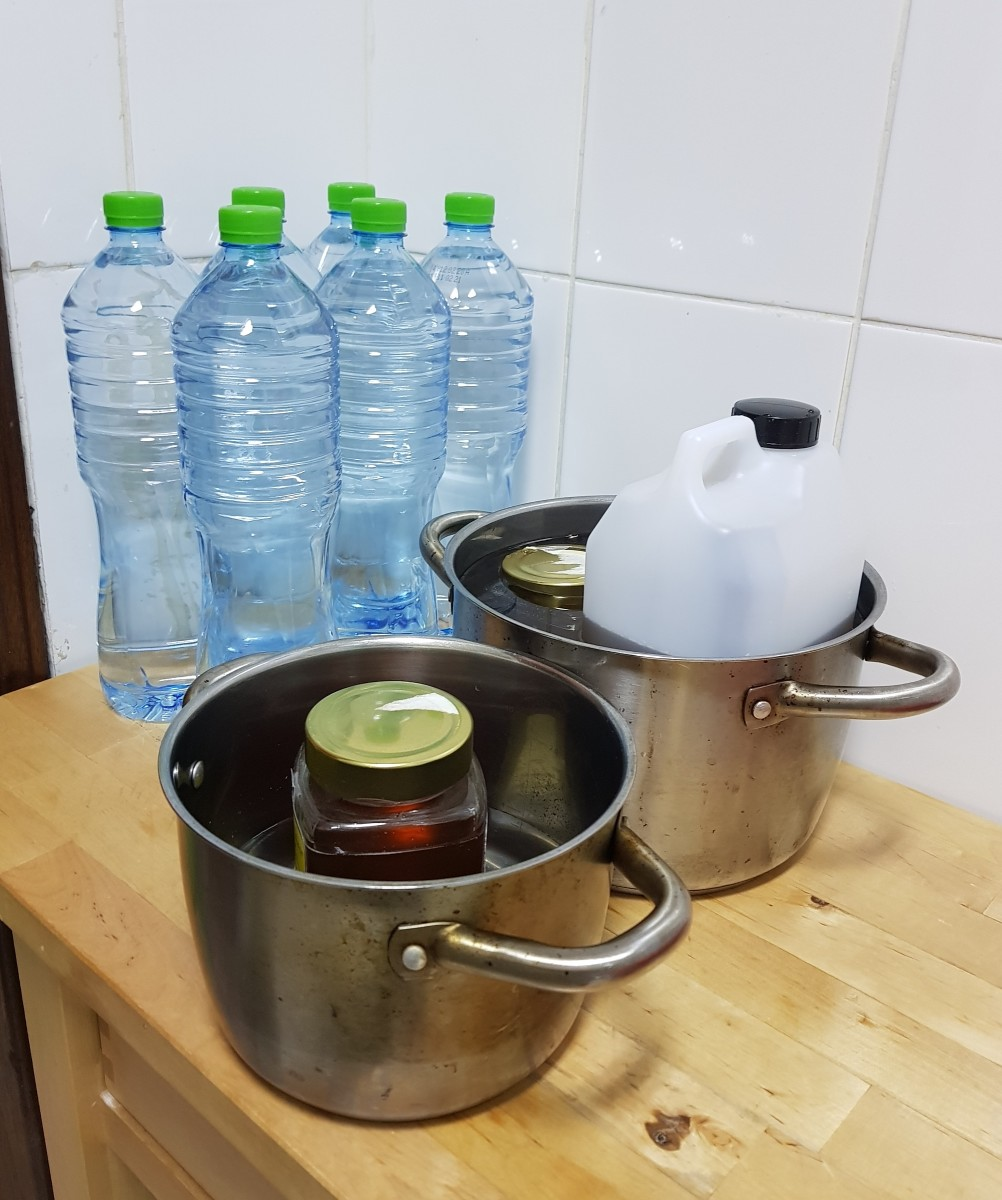 Make the honey more fluid by warming it up. Boil a large pot with an inch or two worth of water. Place honey containers into the hot water. Let them rest.