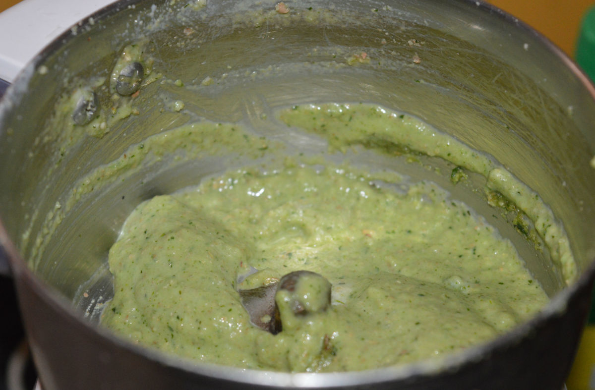 Step 2: In a blender, add roasted peanuts, fresh coriander leaves, green chilies, ginger, and sugar. Grind, adding 1 teaspoon of curd, to get a smooth paste.