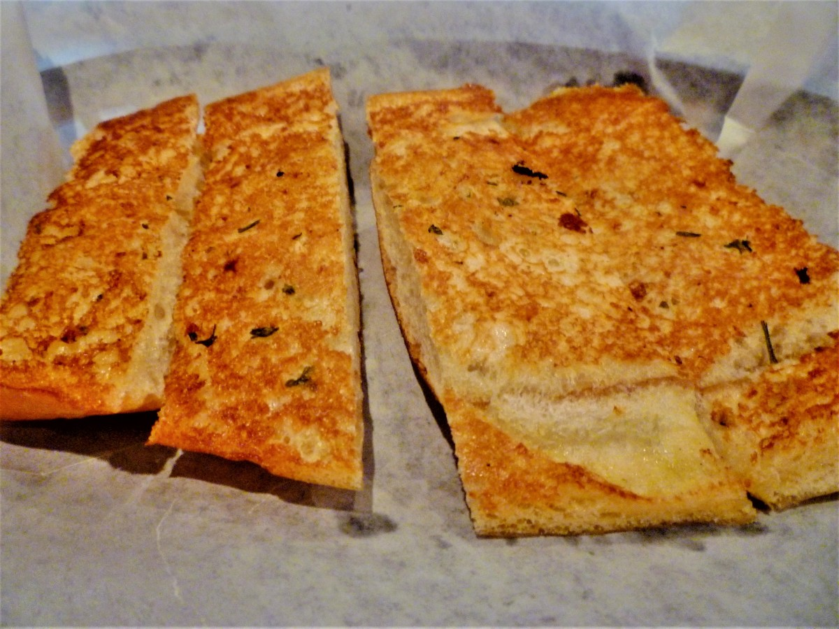 Garlic bread accompanies meals at Clementines