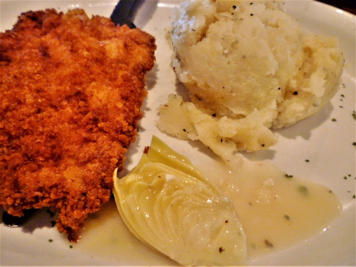 Veal Milanese with artichoke butter and garlic mashed potatoes