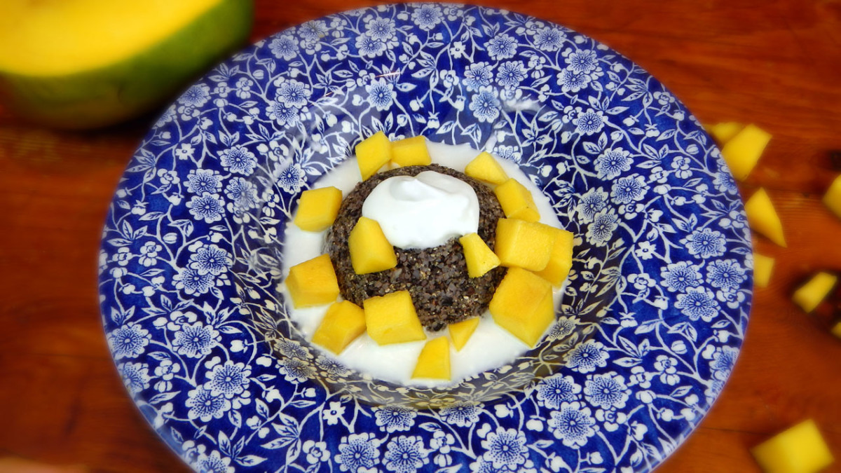 Raw black rice smothered in fresh coconut cream and mangoes (or another favorite fruit)