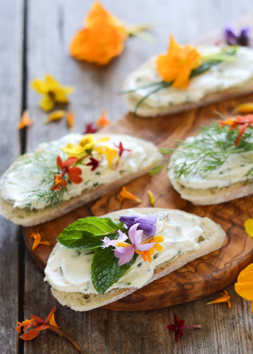 Cream cheese and chive sandwiches with edible flowers