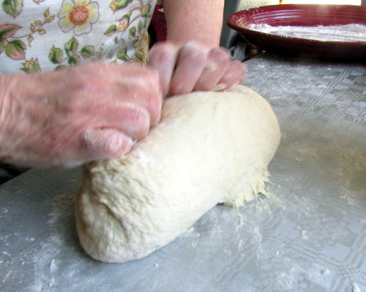 Knead the dough by turning it around again and again.