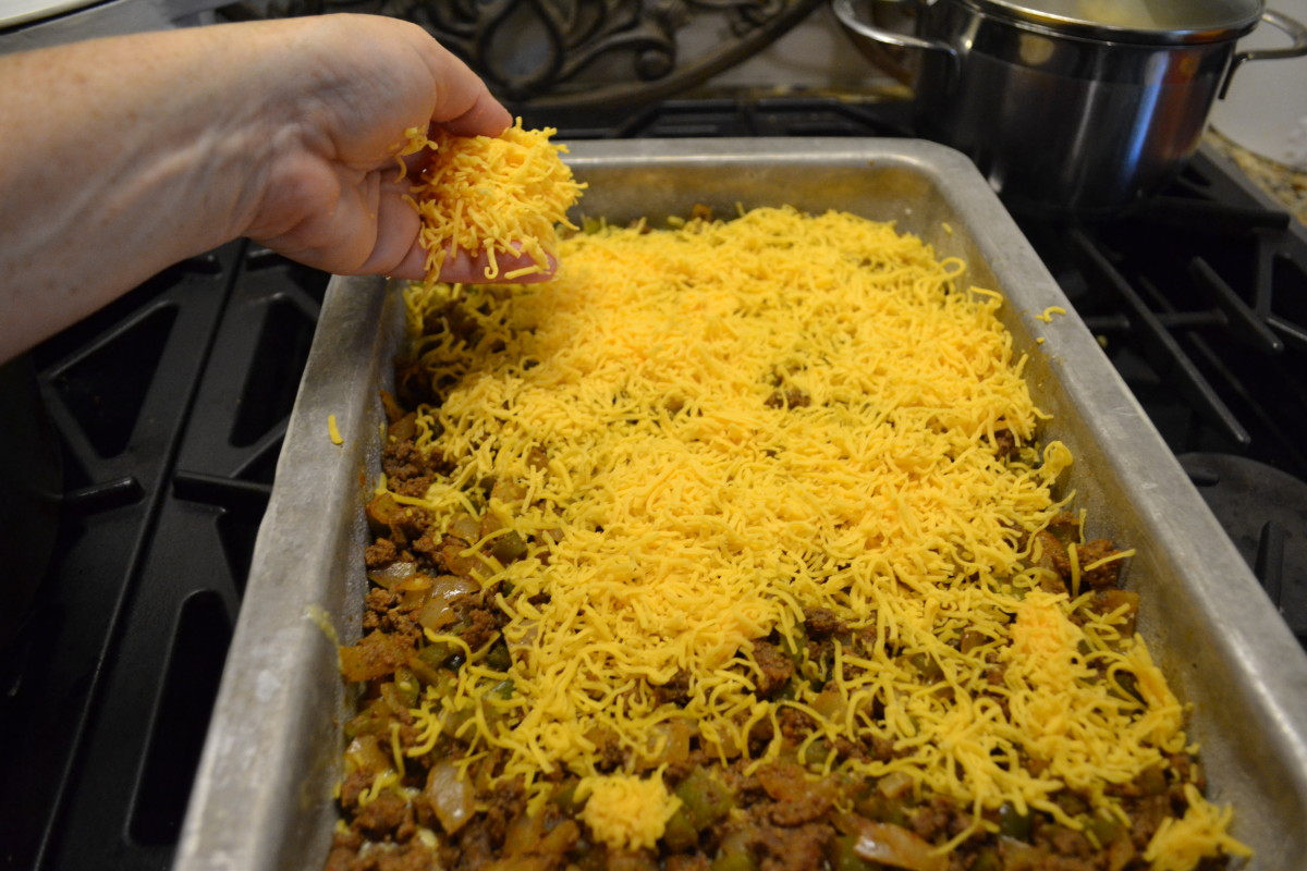 Evenly spread the grated cheese atop the meat layer.