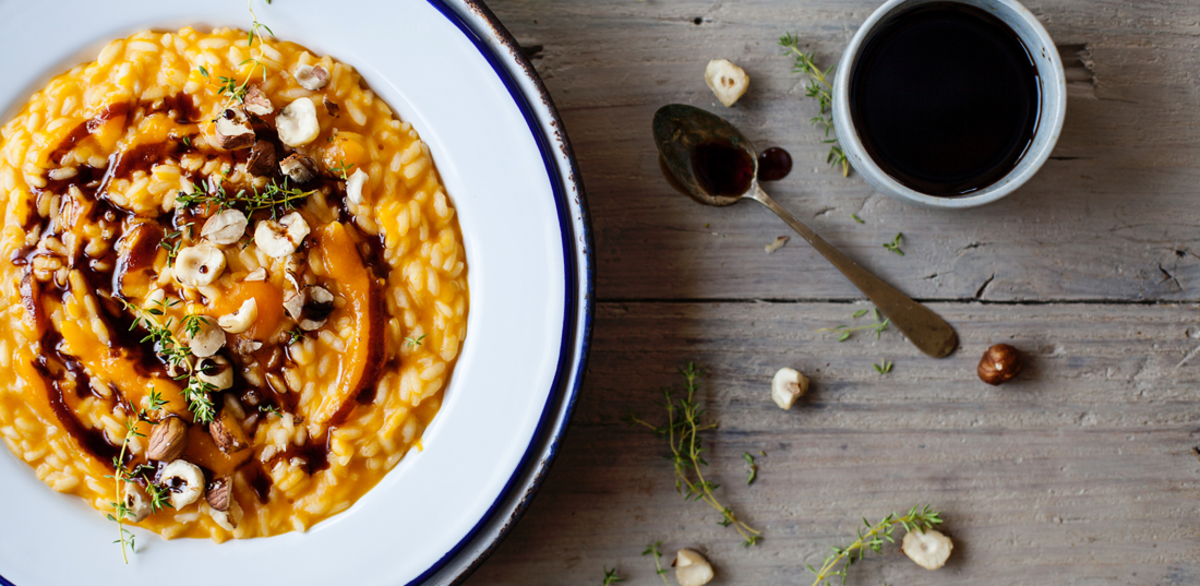 Risotto with pumpkin cream, balsamic, and hazelnuts
