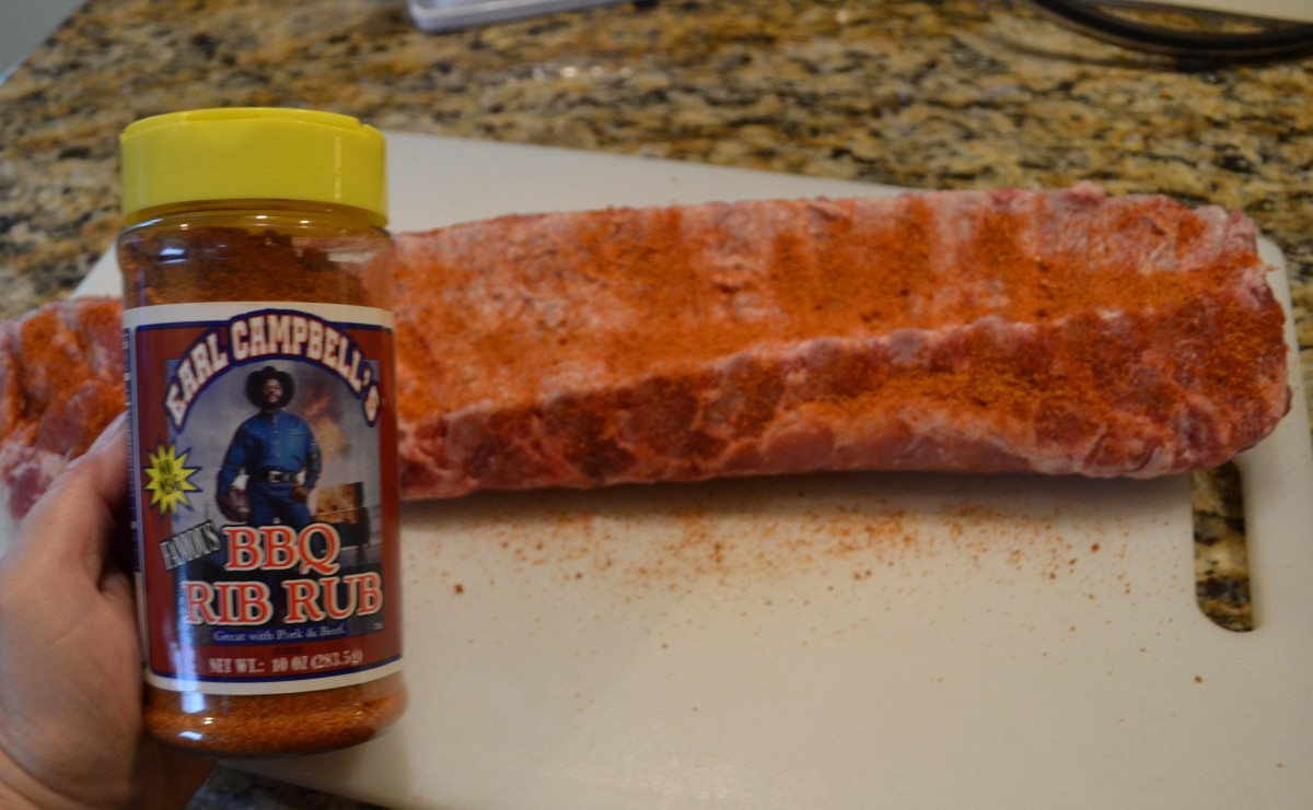 Generously sprinkle ribs with your favorite rib rub and gently rub or press into meat. We love Earl Campbell's Famous BBQ Rib Rub.
