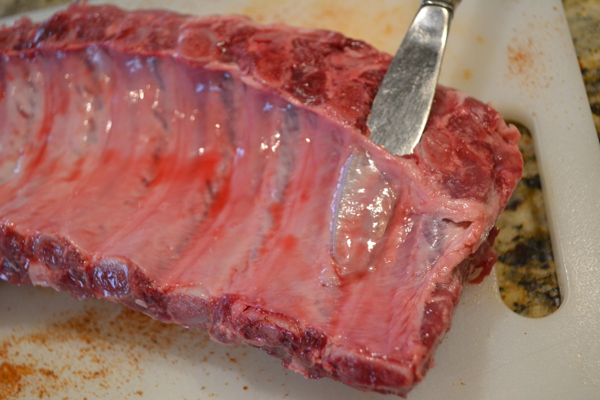 Slide a butter knife under the membrane to lift the membrane up from the meat on one end.