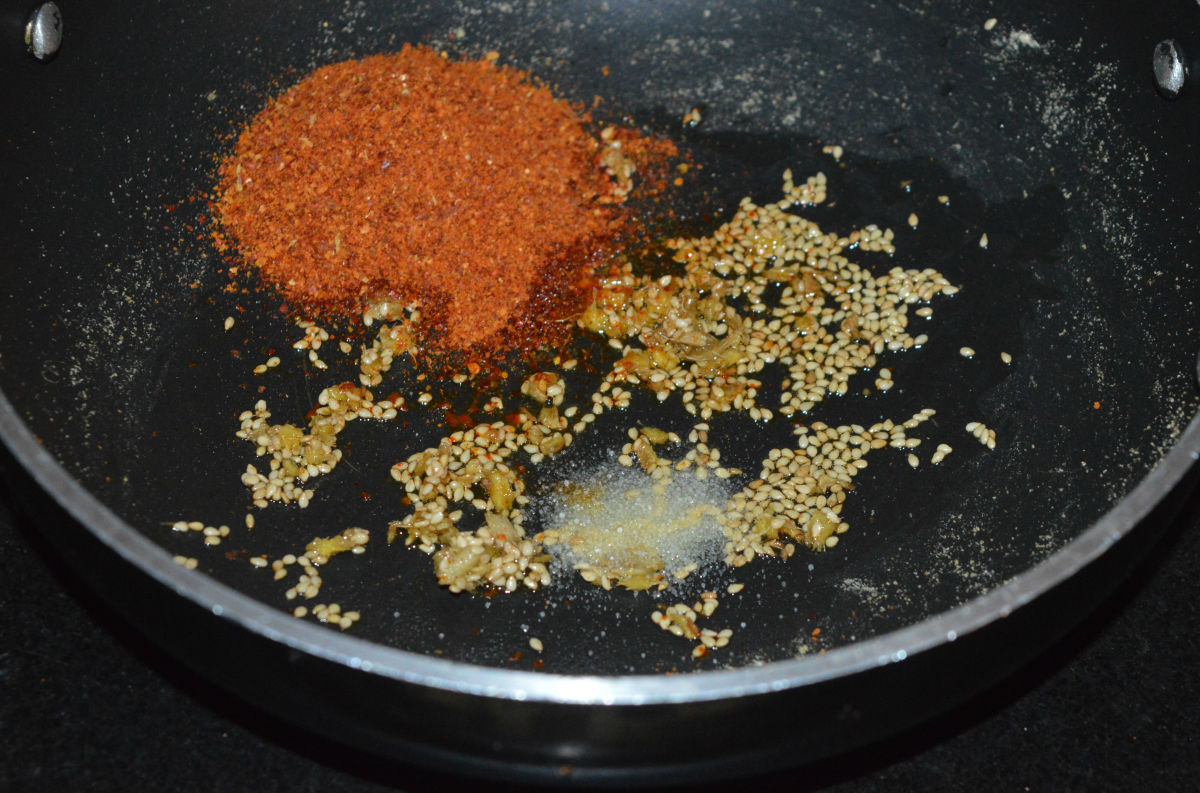 Add spice powder and some salt to the mixture. Mix well. This makes the stuffing for the spicy parathas.