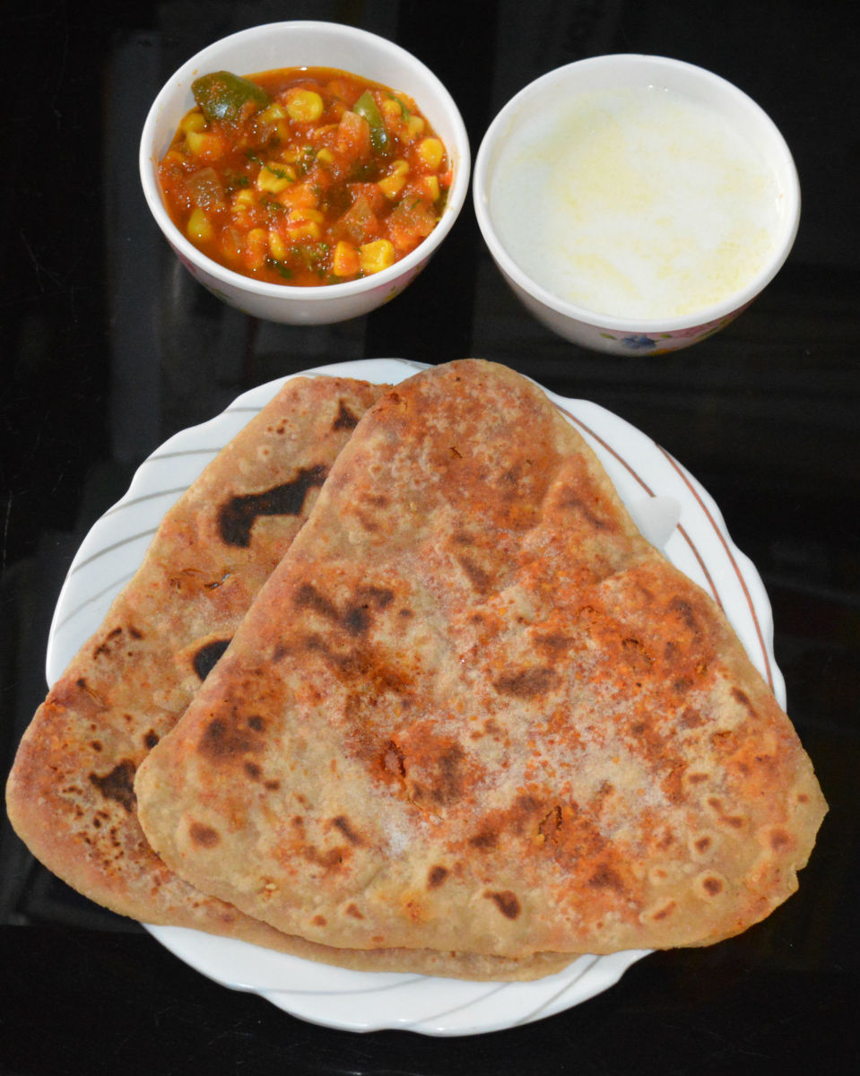 Similarly, make all the parathas. Enjoy it hot with thick curd or yogurt or a mild spicy curry.