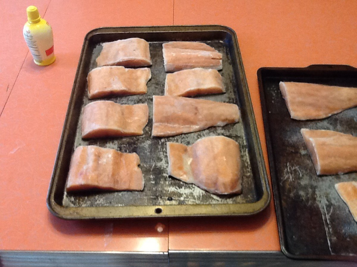 Place the salmon fillets on the greased baking sheet.