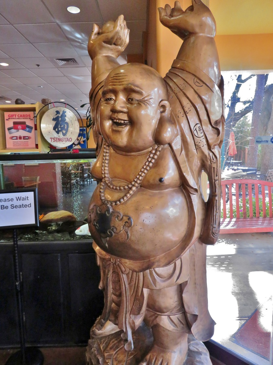 Do you want to rub his belly? He greets you both entering and exiting the restaurant.