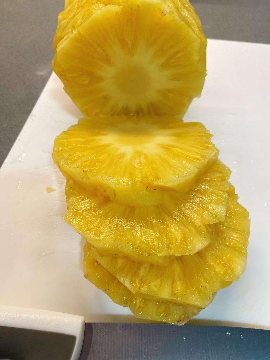 Slice the pineapple.