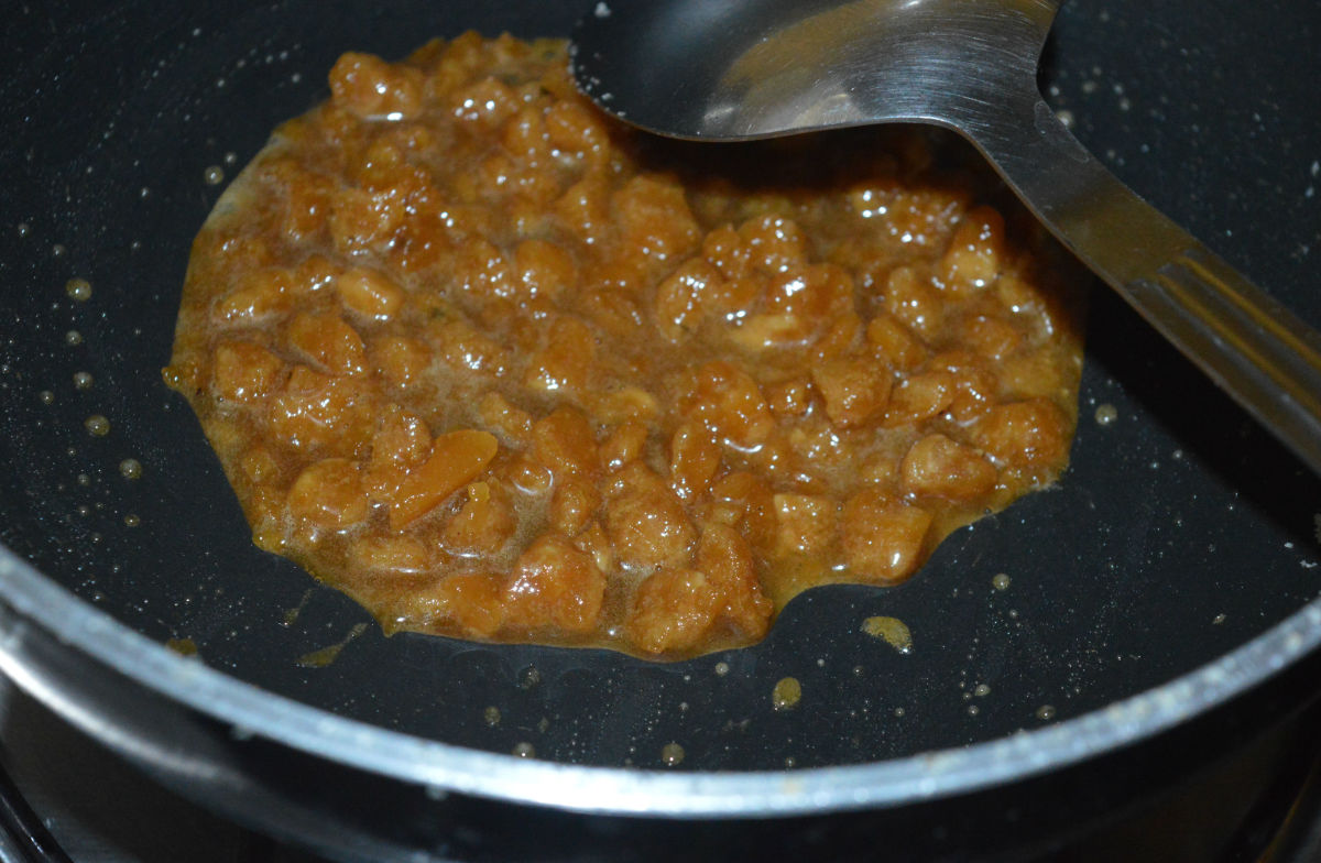 Step three: Add powdered jaggery and 1 teaspoon water to the same pan.