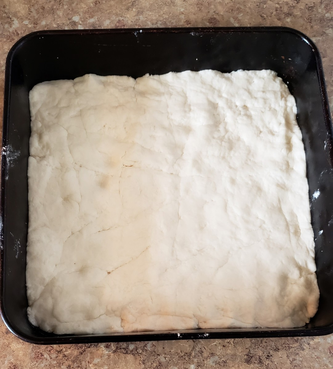 Spread dough into a greased 9x9 baking pan.