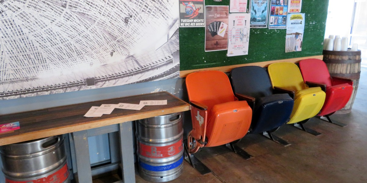 Old Astrodome seats inside of the 8th Wonder Brewery
