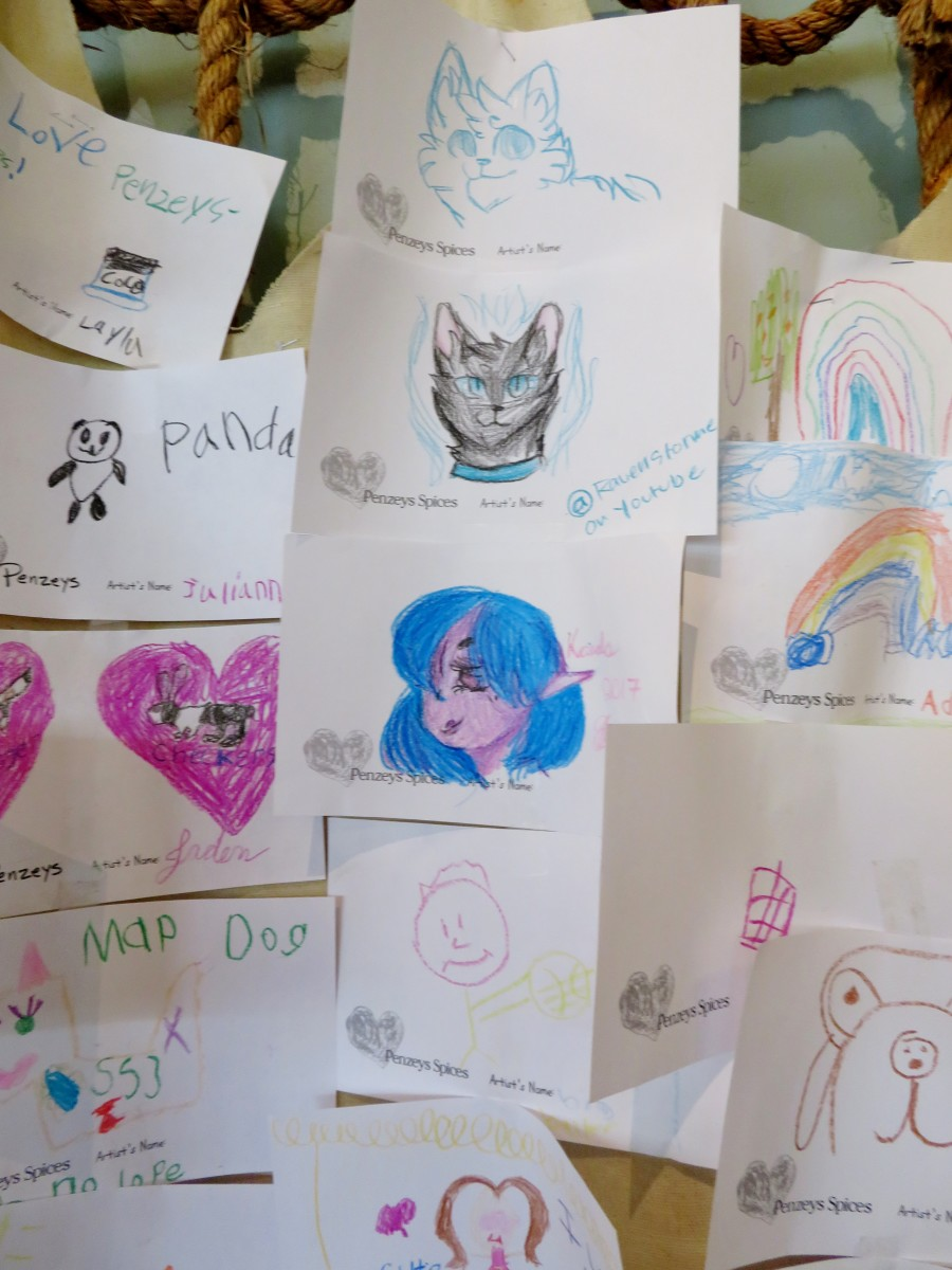 Art drawings by children on display inside of the store