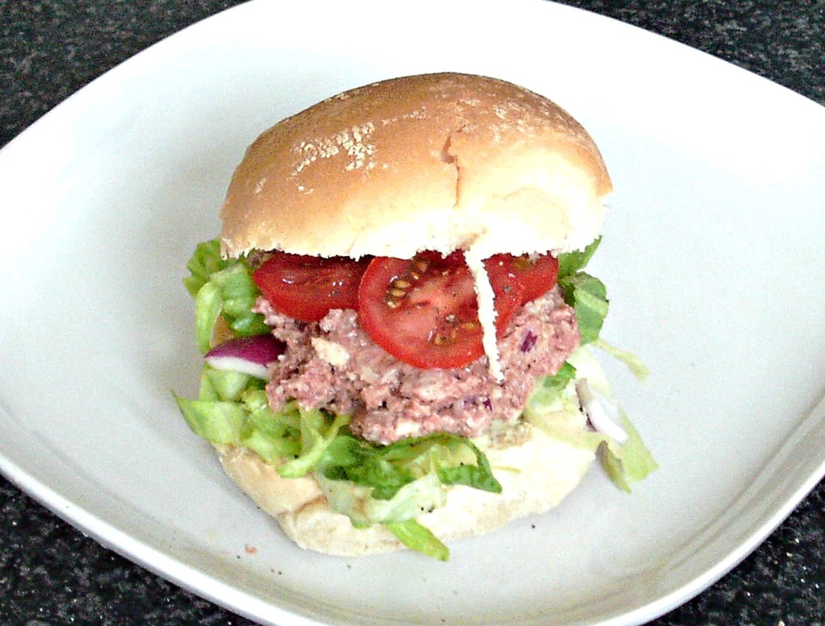 Mashed Corned beef and horseradish sauce is sandwiched with a simple salad and sliced tomato