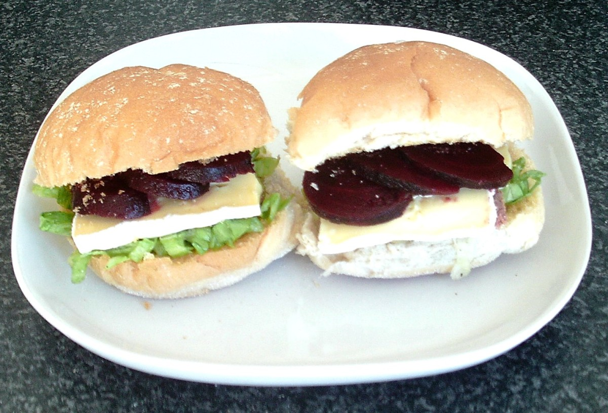 Sliced corned beef, beetroot and brie are combined with simple salad on toasted bread rolls