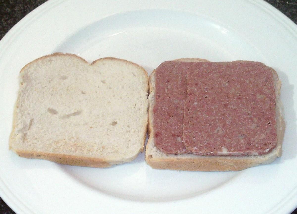 Corned beef arranged on one slice of bread