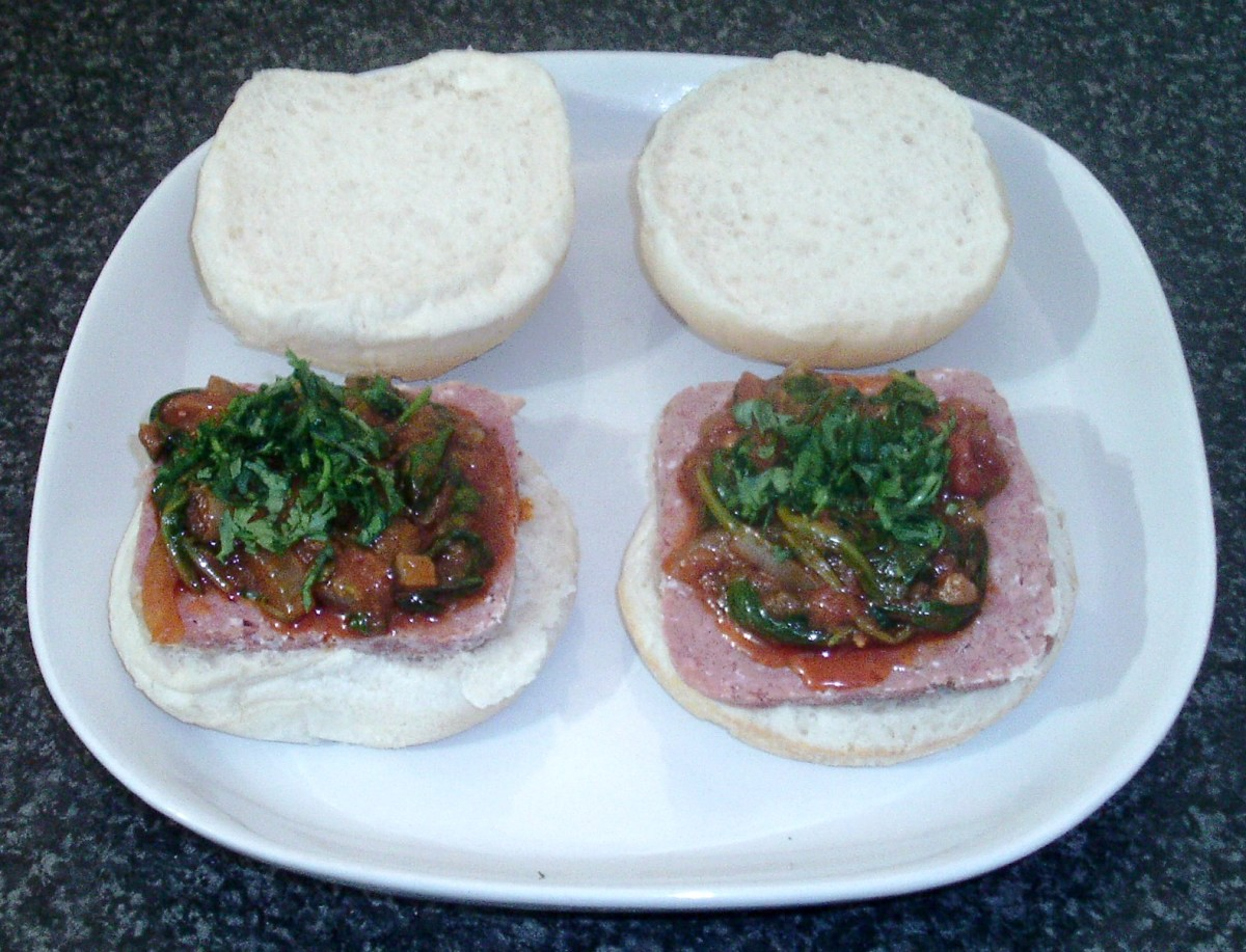 Spinach curry is spooned on to corned beef and topped with freshly chopped coriander/cilantro
