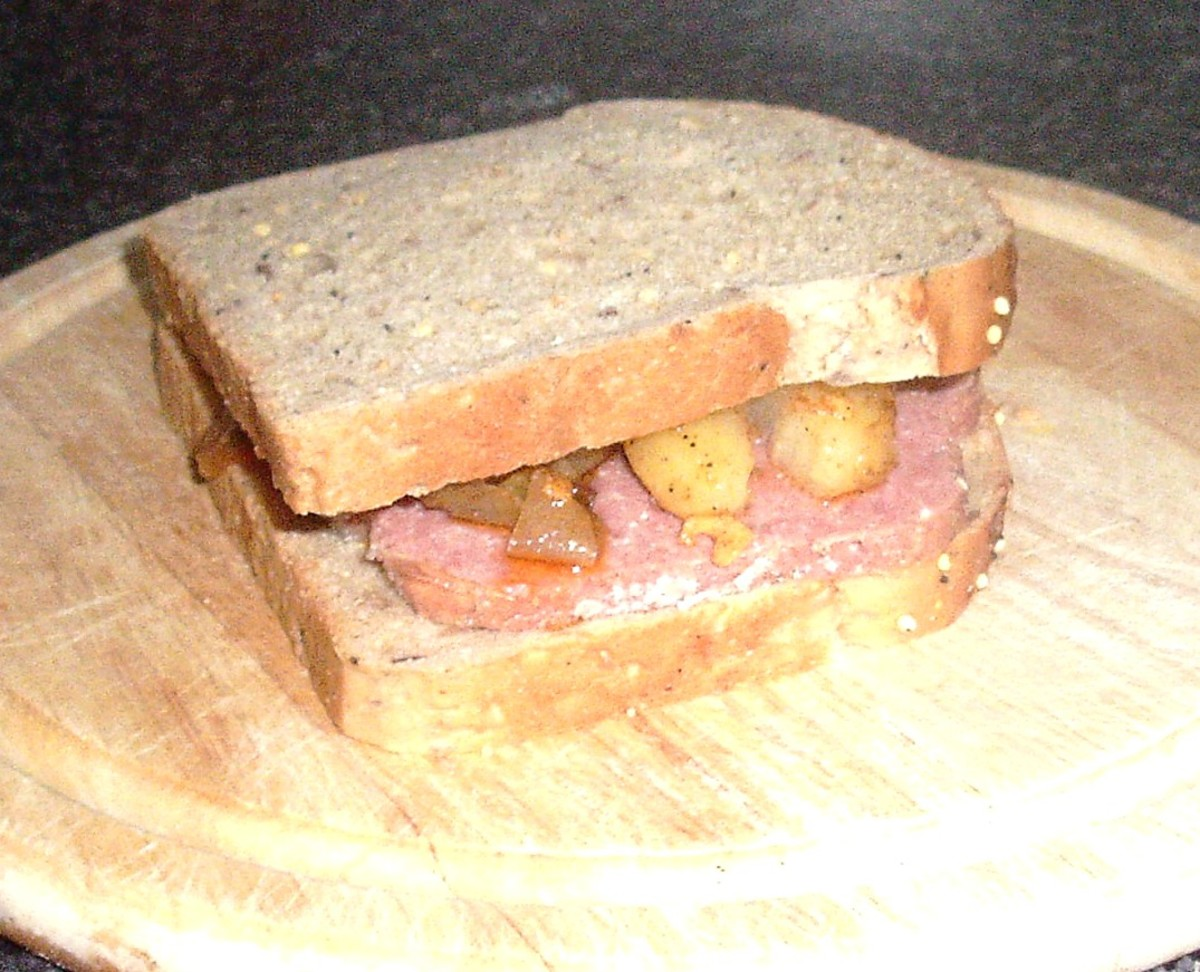 Top is placed on corned beef with spiced potatoes and onion sandwich