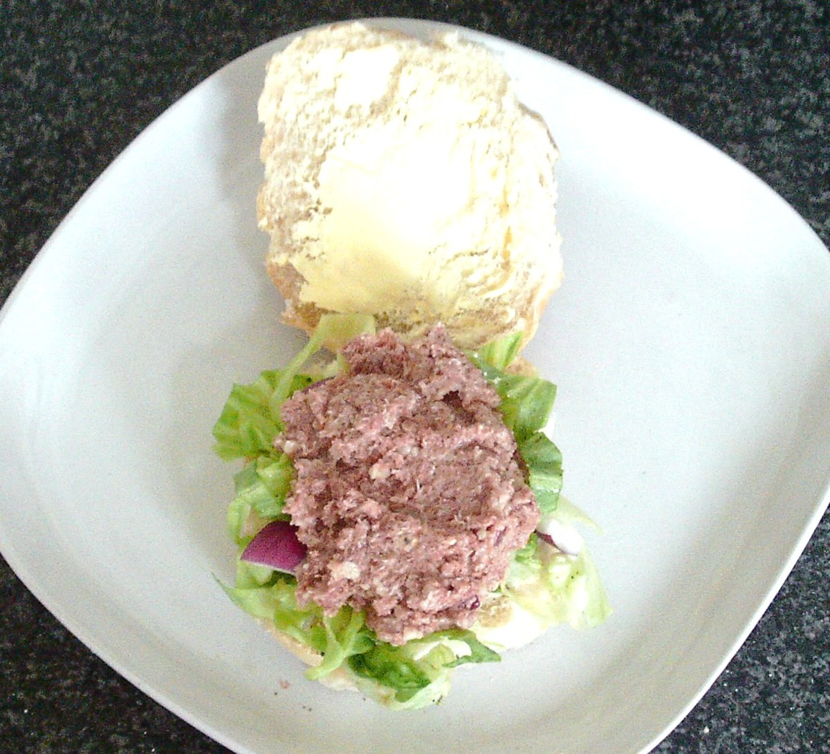 Corned beef mash is spooned on to salad bed